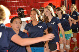 "Girls Volleyball Team's ""Good Game"" high fives."