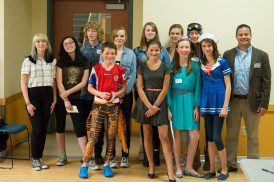 Presenting team members, current students and alumni with our Environmental Slam coach, Tim Owens.