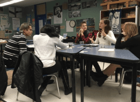 """Explorer West alumni , Cyrus Storlie, Makenzie White and Tess Wassermann met with Seattle Parks Officials to discuss plans for Lincoln Park's """"inclusive"""" playground as a result of their """"Change The World"""" project."""