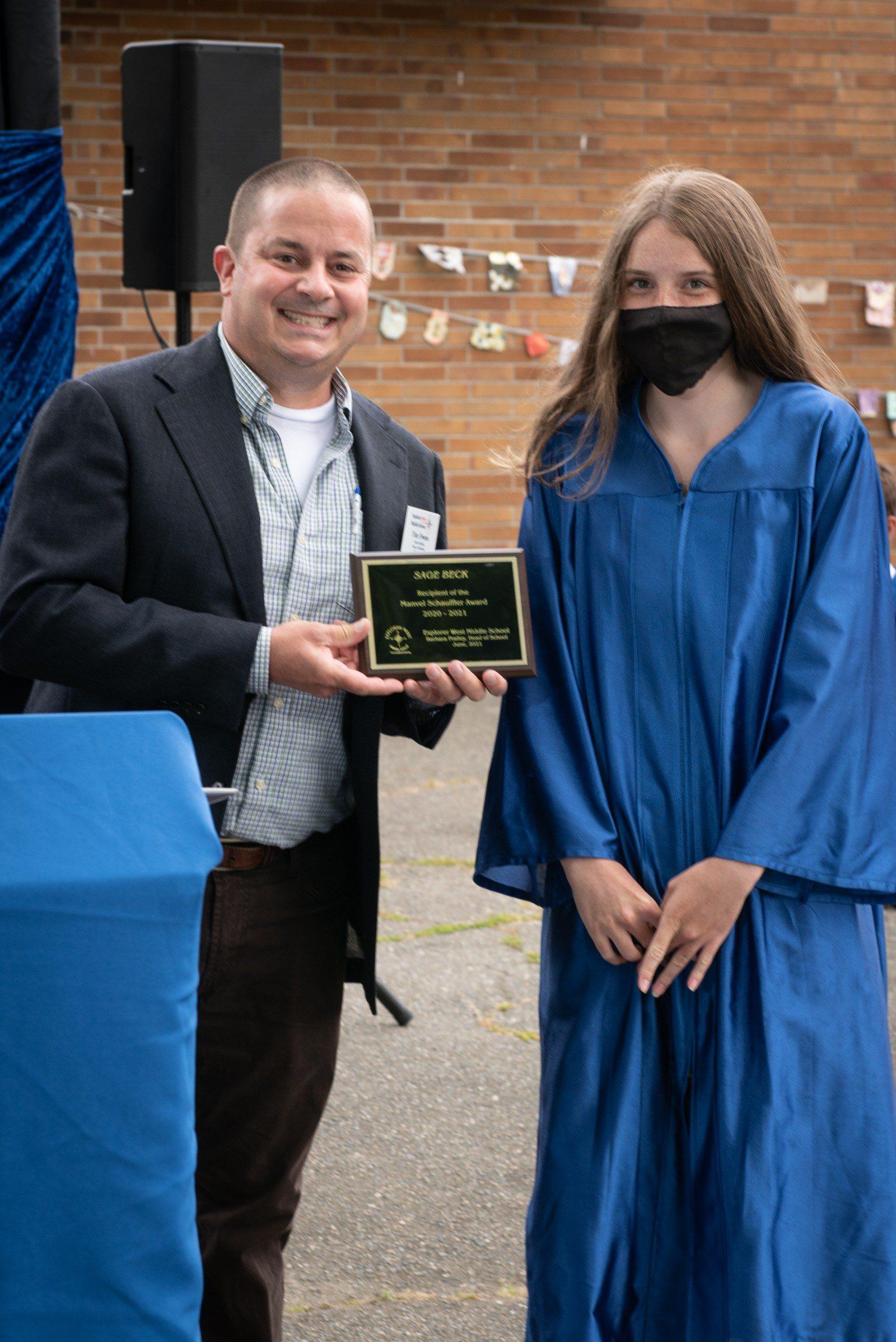Tim Owens, Dean of Students, presents the Schauff Award